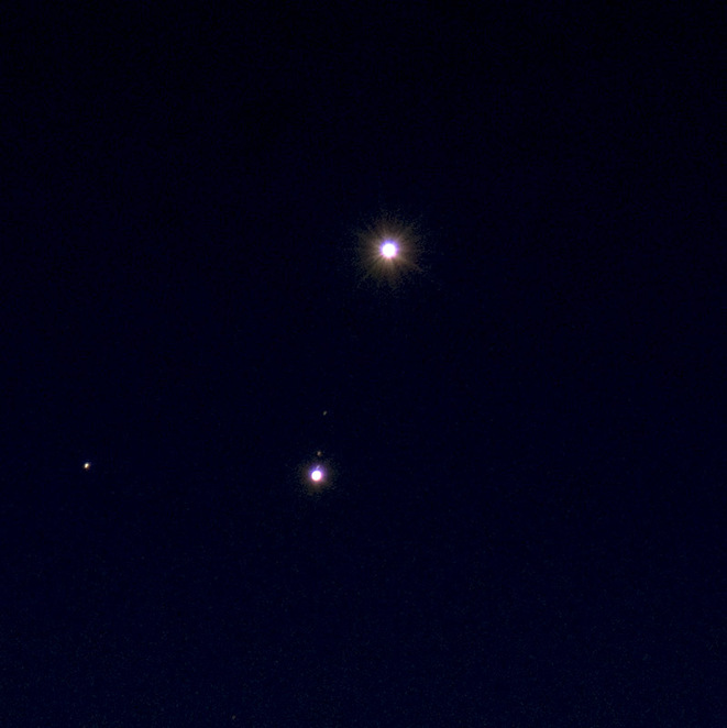 Photo of a Venus and Jupiter conjunction courtesy of cafuego @ Flickr