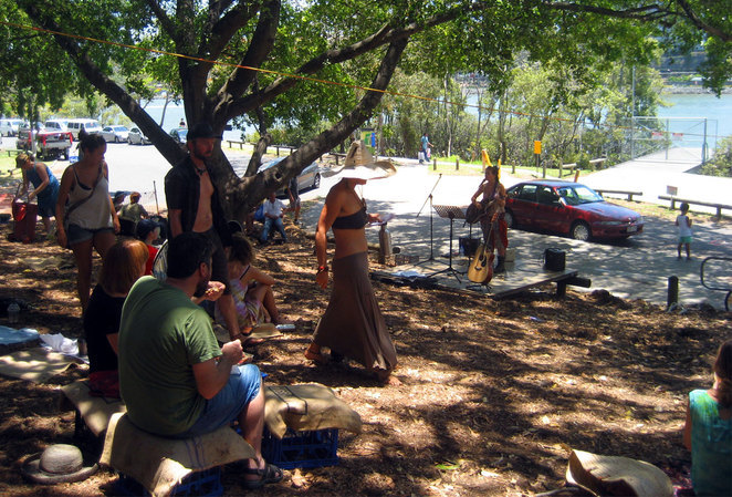 People enjoying entertainment at the Davies Park Markets