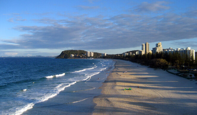 Burleigh Beach with Burleigh Heads National Park in the background