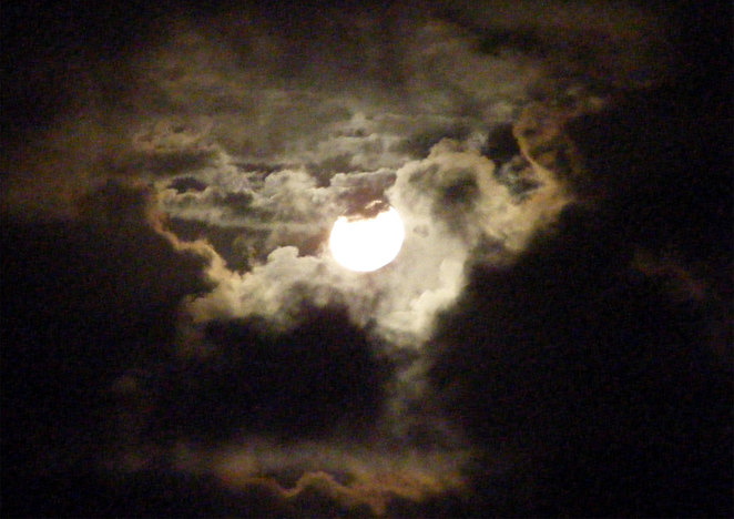 A supermoon behind the clouds