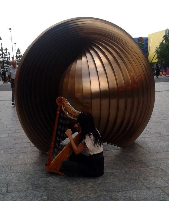 Artwork in Queen Street Mall and harp player
