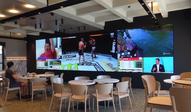 large screens, indoor seating, bar