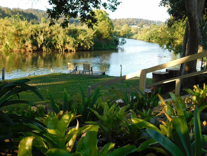 Riverbend Lodge Waterfront Accommodation, location, Mudjimba, solitude, semi-rural, off-leash walking dogs, fishing, kayaking, jet skiing, kayaking, Leopards Lair, cottage, Eagles Nest, studio cabin, river views, covered verandahs, bonfire pit, riverfront gas BBQ, linen included, BYO food, 2 night stays accepted, slice of heaven, home-away-from-home, adventure