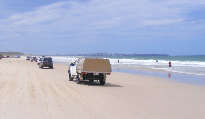 Four wheel drives at low tide on Bribie Island