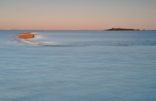 The sand bar at Wellington Point being swallowed by the high tide