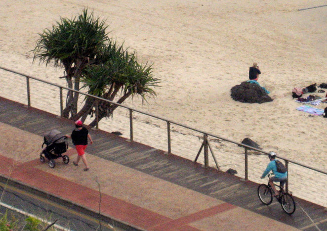 Cycling and walking by the beach in Kirra