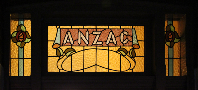 The Not-So-Ugly-Men at ANZAC Cottage, historical memorial house and museum built in one day, leadlight over door entry glass