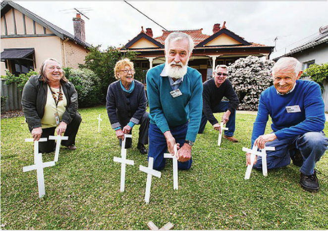Vincent Men's Shed make white crosses for ANZAC Cottage 'Field of Remembrance
