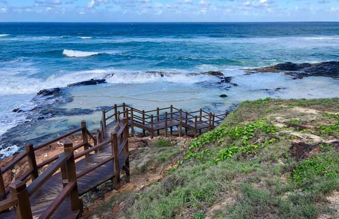 Champagne Pools and boardwalk to the north of Dundubara is another popular swimming area
