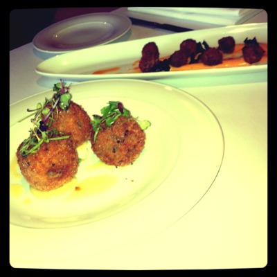 Mozzarella & mushroom arancini, garlic purée $10 & Jumbo green olives stuffed w goats feta & herb crumbed paprika aioli $9 (Photo by Neels McGee)