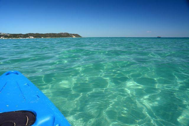 Kayaking and snorkeling in the clear waters around Tangalooma Wrecks