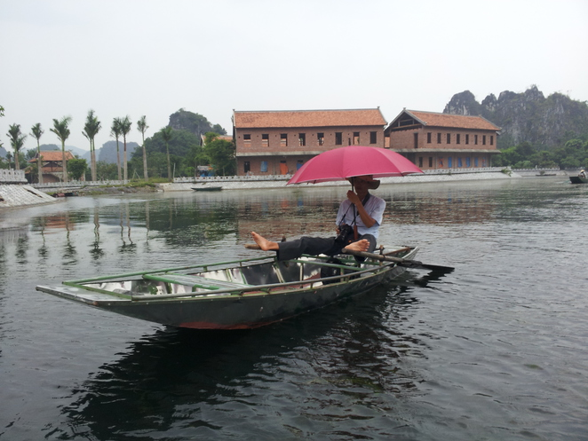 row boats feet Tam Coc Vietnam