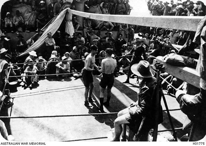 Life on Board the Troopships at ANZAC Cottage. At Sea, the first of the welterweights about to start their boxing match on board the HMAT Takada (Photo courtesy AWM Image H01775).