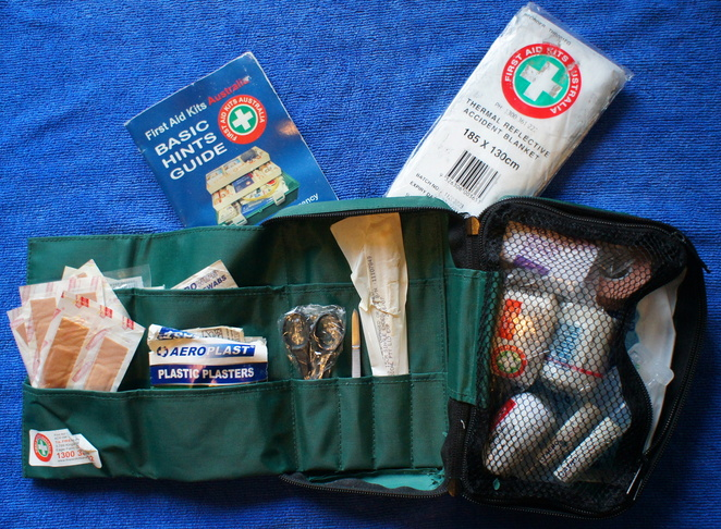 A first aid kit including survival blanket and first aid guide