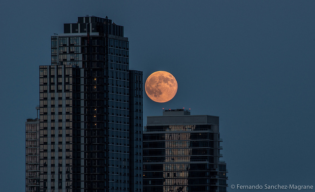 Supermoon and buildings (Attribution: Flickr - Fernando Sanchez-Magrane)