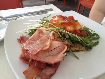 The herb corncake with bacon, poached eggs, rocket and chilli jam ($16.90)