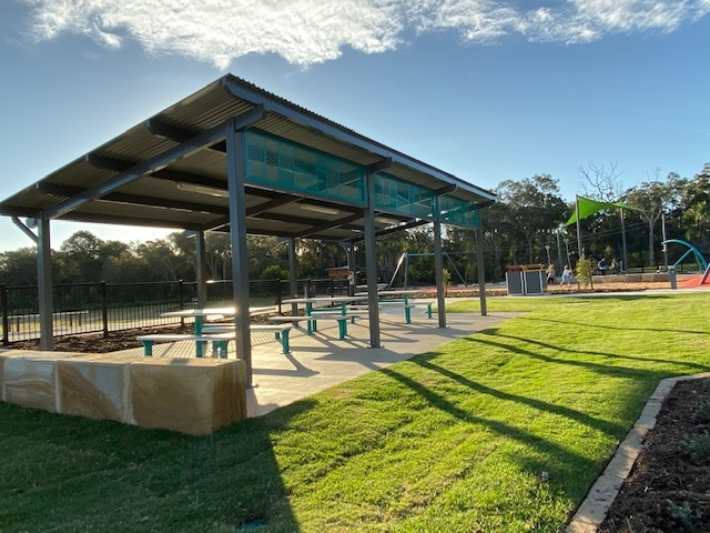 This large shaded picnic shelter with electric BBQs offers views of the adjoining oval at the park for parents with older children who wish to bike, skate, or scoot while their younger siblings play