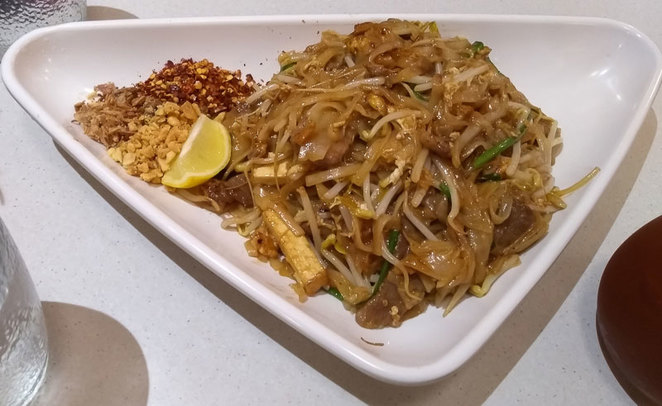 The Pad Thai with spices in the corner!