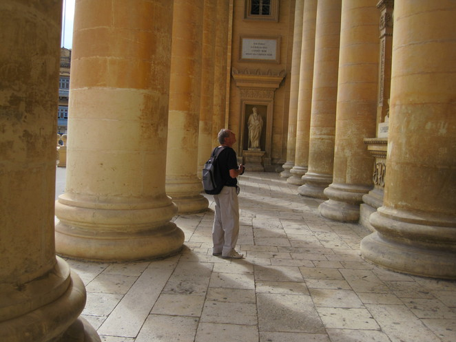 Colin explores the colanades at the entrance to Mosta's rotunda