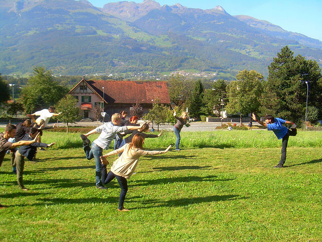 An outdoor yoga class in Europe. This image is from Wikimedia Commons (by Vahagn).