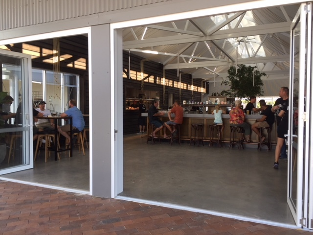 The Dock at The Wharf, Mooloolaba, facelift, newly-opened, three bars, caters for more than three hundred people, relaxed, family friendly, riverside location, Mooloolah River, high ceilings, function style rooms, fifty-two beer taps, sixteen different top-quality beers, entry garden courtyard with bar, river bar, smoked meats, charcoal grills, fish, burgers, kids menu, lunch, dinner, drinks, snacks, special occasions, extended hours New Year's Eve