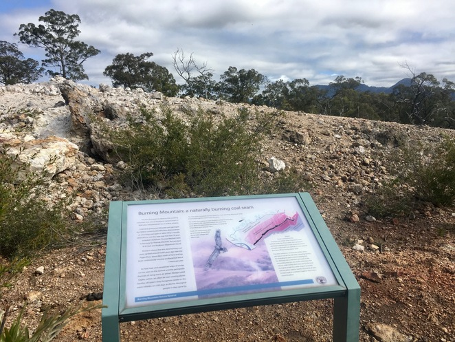 Interpretive signs are installed along the trail