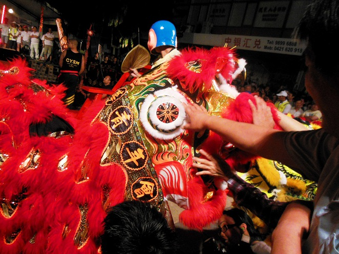 lunar new year touching the lion head for luck