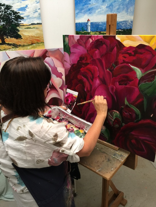 Artist Ria Brenchley working on flowers