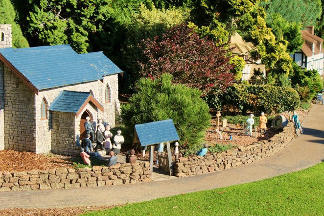 A miniature church and people
