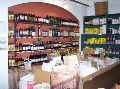 An impressive selection of olive oils and loose dry goods inside the store.