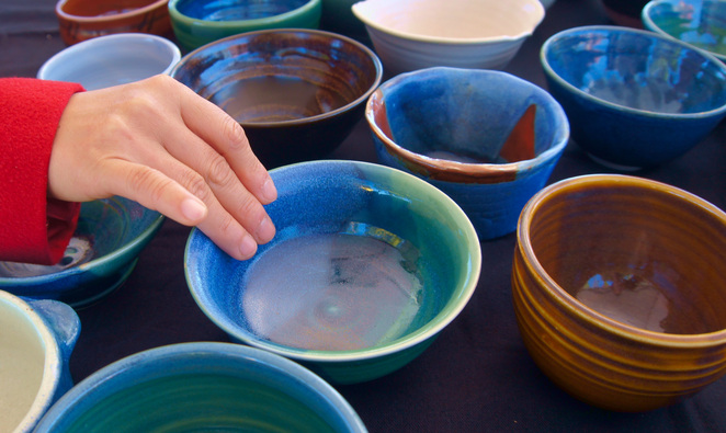 Choosing which handmade bowl to get at a Stanthorpe Pottery Club Soup Day fundraiser