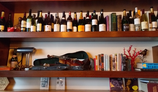 Shelves lined with books and knick knacks at Arthur Radley Bistrot. Image credit: Aridhi Anderson.