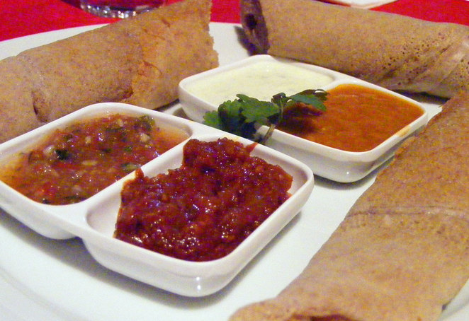 Injera Bread and sauces at Mu'ooz