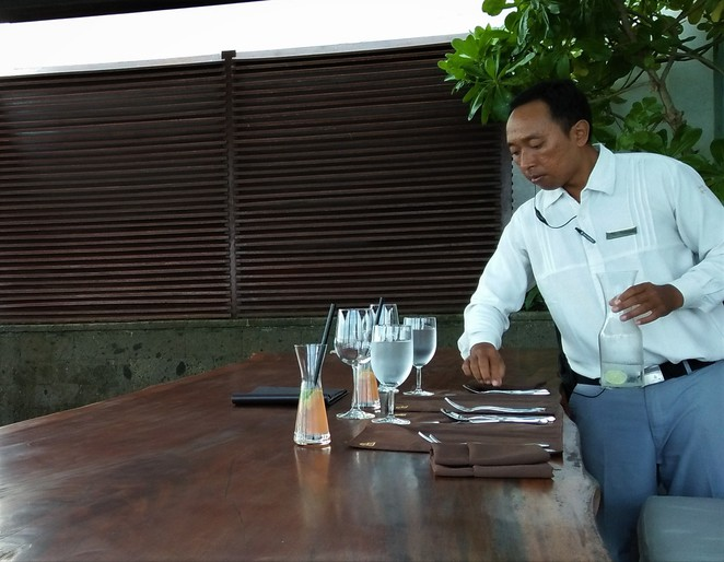 setting the table at restaurant in Bali
