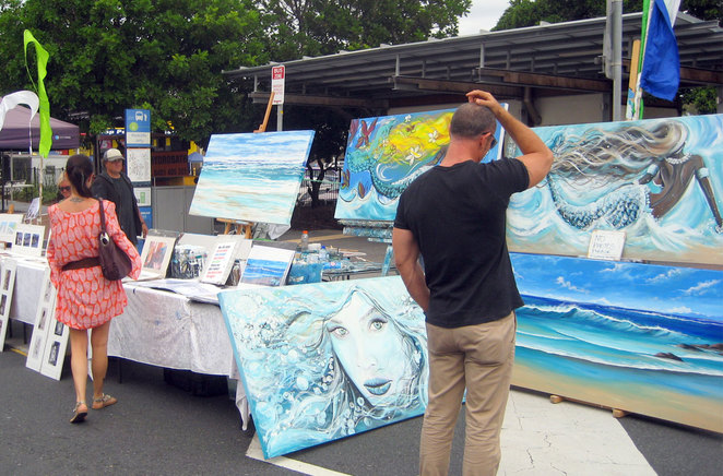 Local artists selling paintings at the Redcliffe Markets