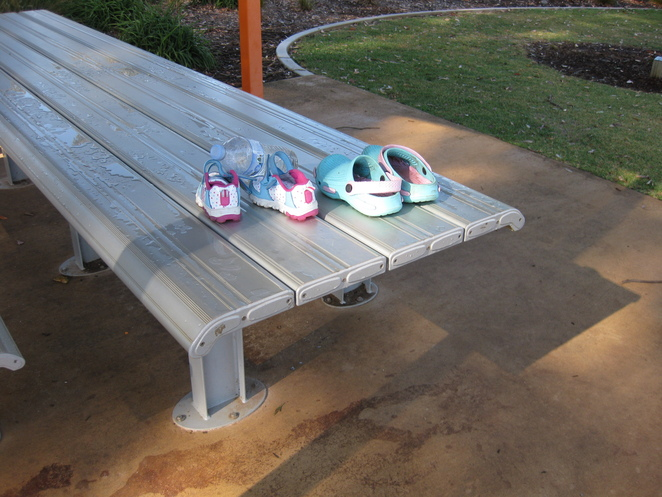 childrens' shoes left behind table