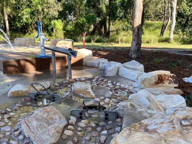 This gorgeous, shaded water play area will provide younger children with hours of fun