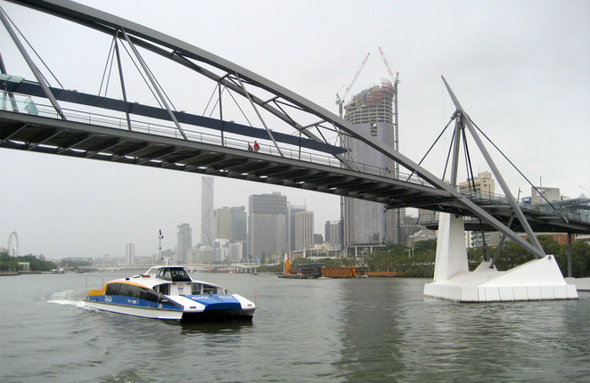 A CityCat makes its way from South Bank under the Goodwill Bridge