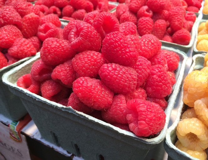 Deliciously ripe raspberries at Granville Island Public Market