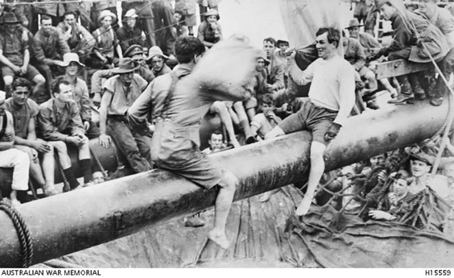 Life on Board the Troopships at ANZAC Cottage. Life on the troopships during the World War I voyages was not all bad - some fun was to be had. Here we see some fellows indulging in a greasy pole pillow fight contest as they wend their way home on the troopship Aeneas (A60) in November 1919 through to January 1920 (Photo courtesy AWM H15559).