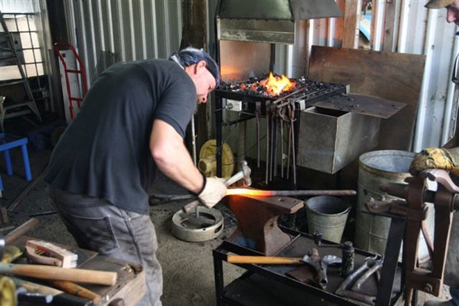 One of the Boyanup Foundation Blacksmiths practising this ancient trade at the South West Rail and Heritage Centre