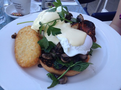 The vegetarian Benny Barrel - poached eggs on English muffin with grilled tomato and house-made hollandaise ($15)