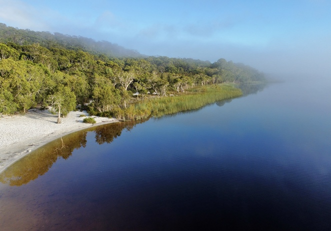 Visit tranquil Bummiera / Brown Lake to swim or look for wildlife