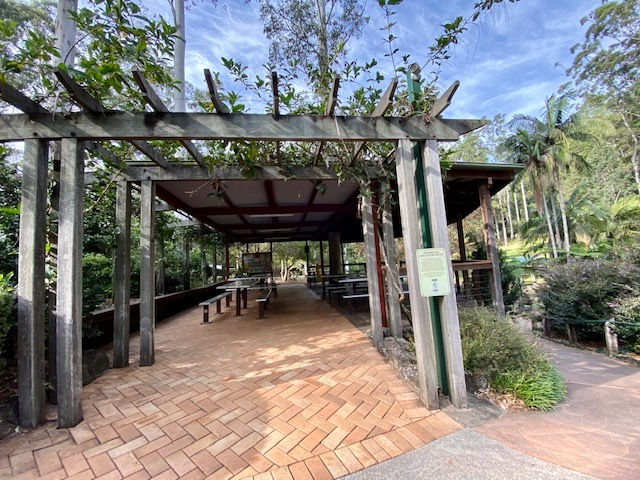 A large picnic shelter near the entrance to the gardens