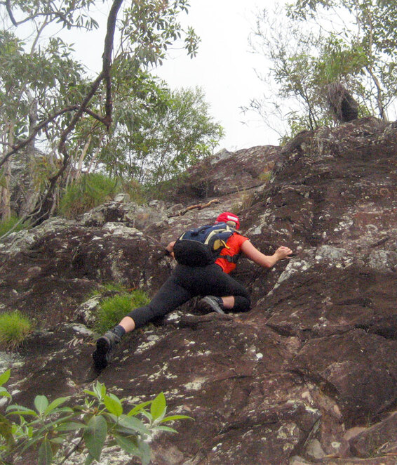 Scrambling up the rock dome at the top of Mt Tibberoowuccum