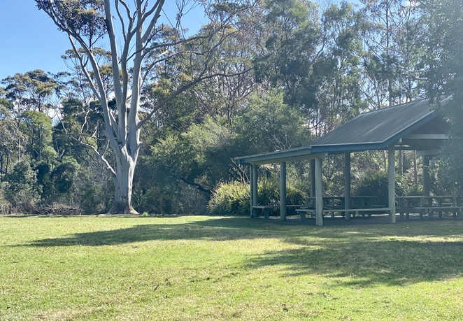 A picnic shelter overlooking the large recreational field at Settlement Day Use Area