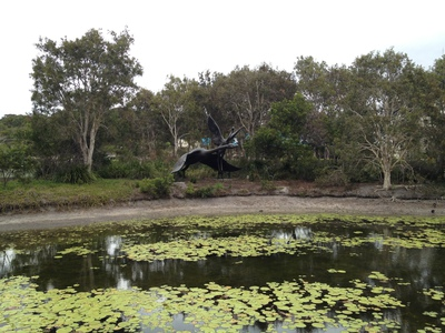 The 'Sisters by Choice' bronze sculpture sits on an island in the middle of the lake