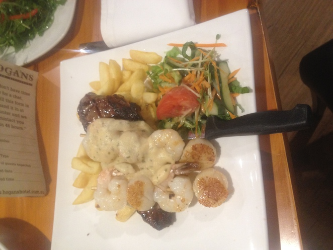 Steak, chips, salad, prawns