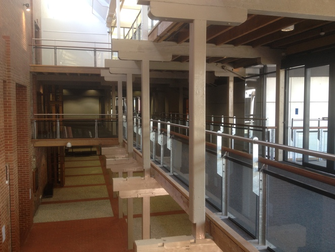 Integration of Wooden Beams with Modern Steel