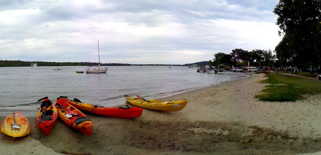 Kayaks on the river bank on Noosa River